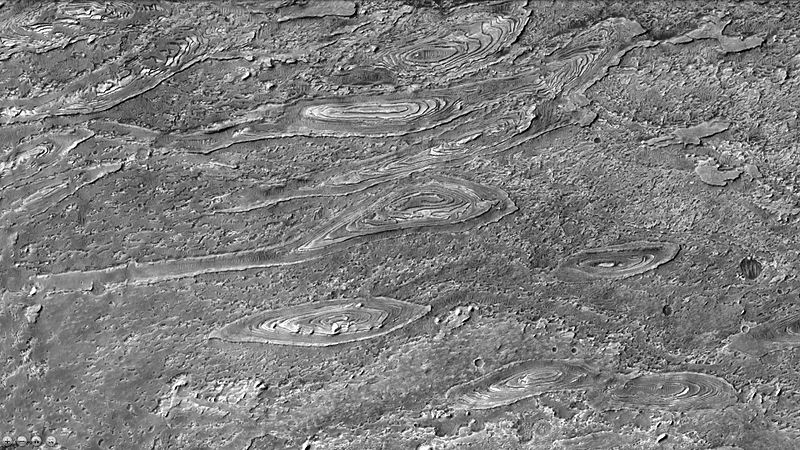 Crommelin Crater showing layers arranged in ovals as seen by ctx
