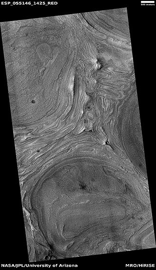 Wide view of features on floor of Hellas impact basin. The exact origin of these shapes is unknown at present.