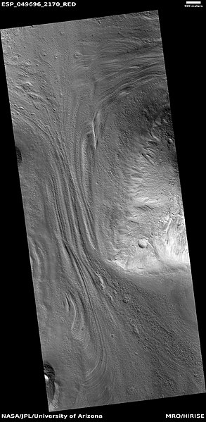 Close view of lineated valley fill on left and mantle on right, as seen by HiRISE under HiWish program