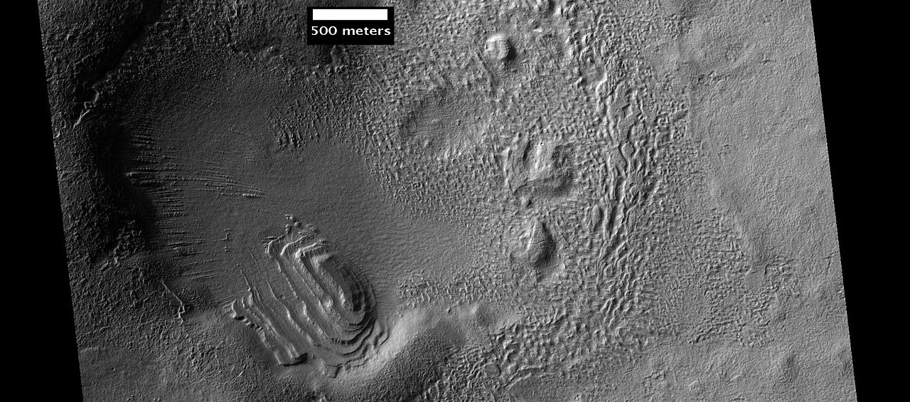Set of dipping layers in crater